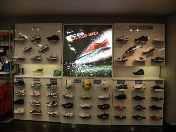 The Nike athletic machine began as a small distributing outfit located in  the trunk of Phil Knight's car. From these rather inauspicious beginnings,  ...